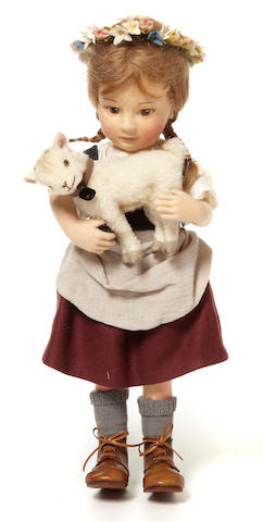 An R. John Wright doll of Heidi and her goat Snowflake
