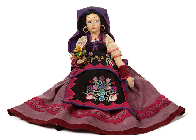 A Lenci lady felt doll in traditional costume
