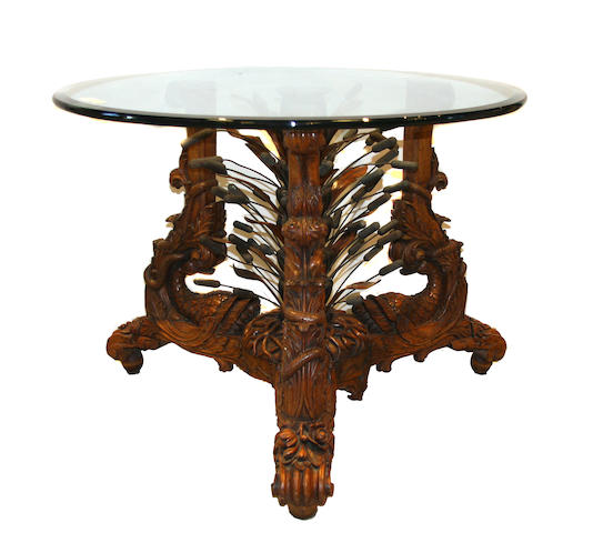 An Aesthetic Revival carved wood and metal center table