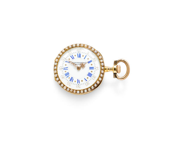 Patek Philippe. A fine 18K gold pearl and diamond set lapel watch with brooch and guard chain en suiteCase no. 214911, movement no. 103228, retailed by Merrick, Walsh & Phelps, St. Louis, MO, 1890's