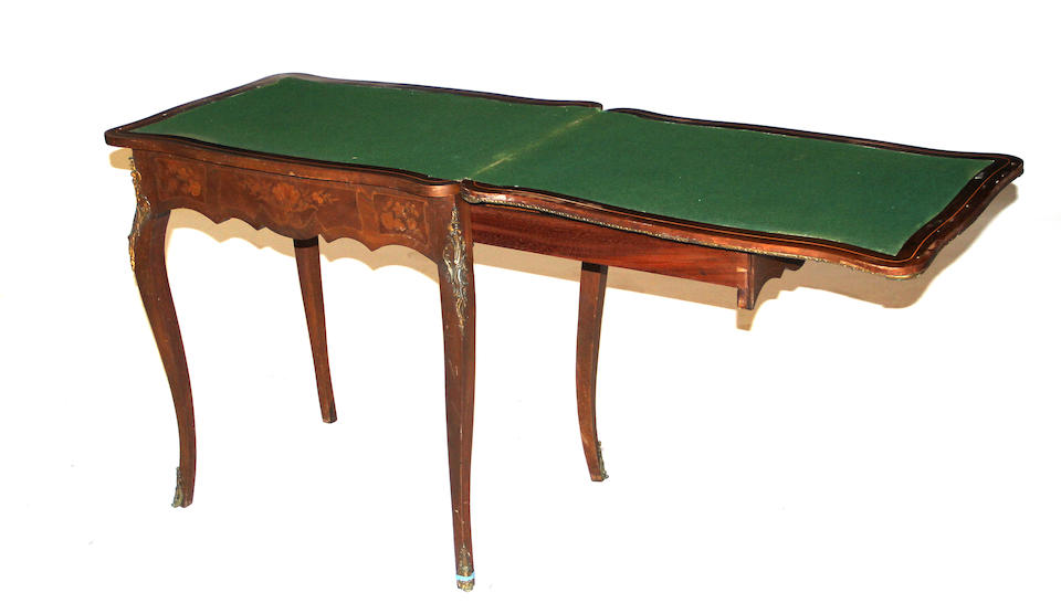 A Napoleon III gilt bronze mounted marquetry games table