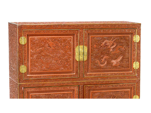 A cinnabar lacquer scholar's chest with dragon decoration 18th/19th century