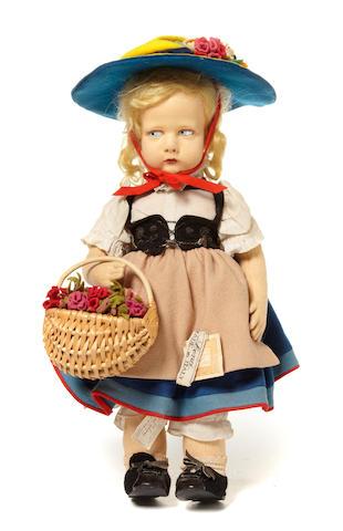 A Lenci felt girl doll in traditional Swiss costume