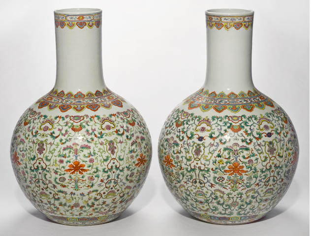 A pair of famille rose enameled porcelain stick-neck vases Qianlong marks, 20th century