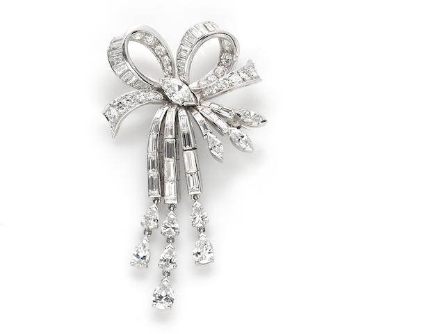 A diamond articulated bow brooch