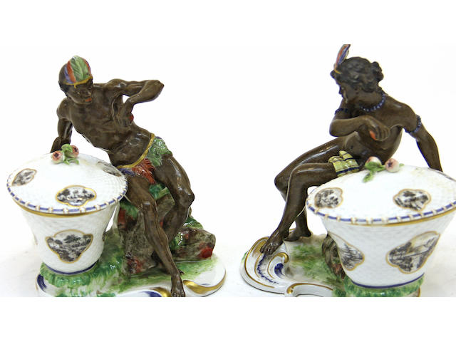 A pair of Nymphenburg porcelain blackamoor covered sweetmeat dishes third quarter 20th century