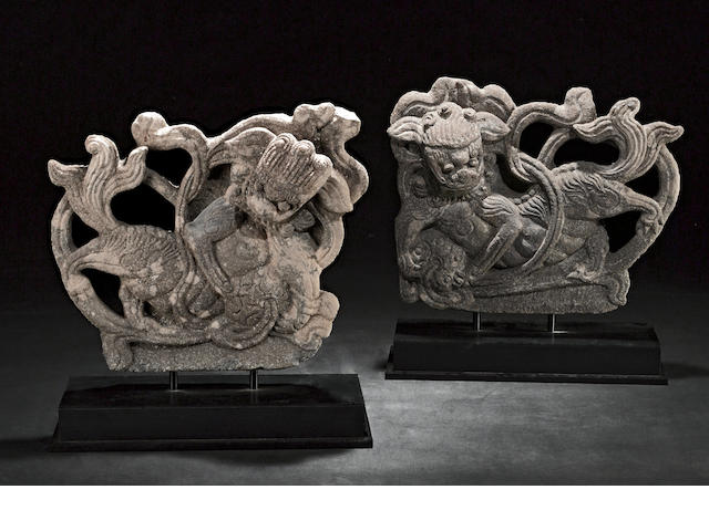 A pair of Chinese carved stone mounted figures of fu lion and ball Song style