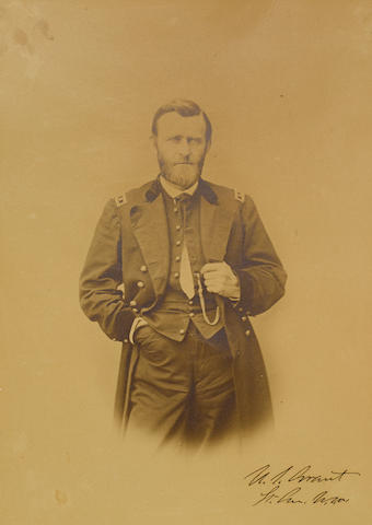 "GRANT, ULYSSES S. 1822-1885. Photograph Signed (""U.S. Grant / Lt. Gen U.S.A.""), imperial albumen print portrait, 10 by 13 inches laid down to larger board, three-quarters length portrait of Grant in uniform,"