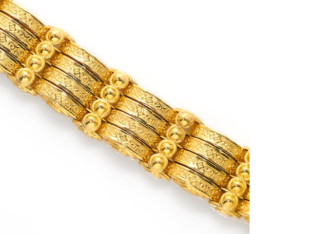 A high-karat gold bracelet suspending a seashell charm