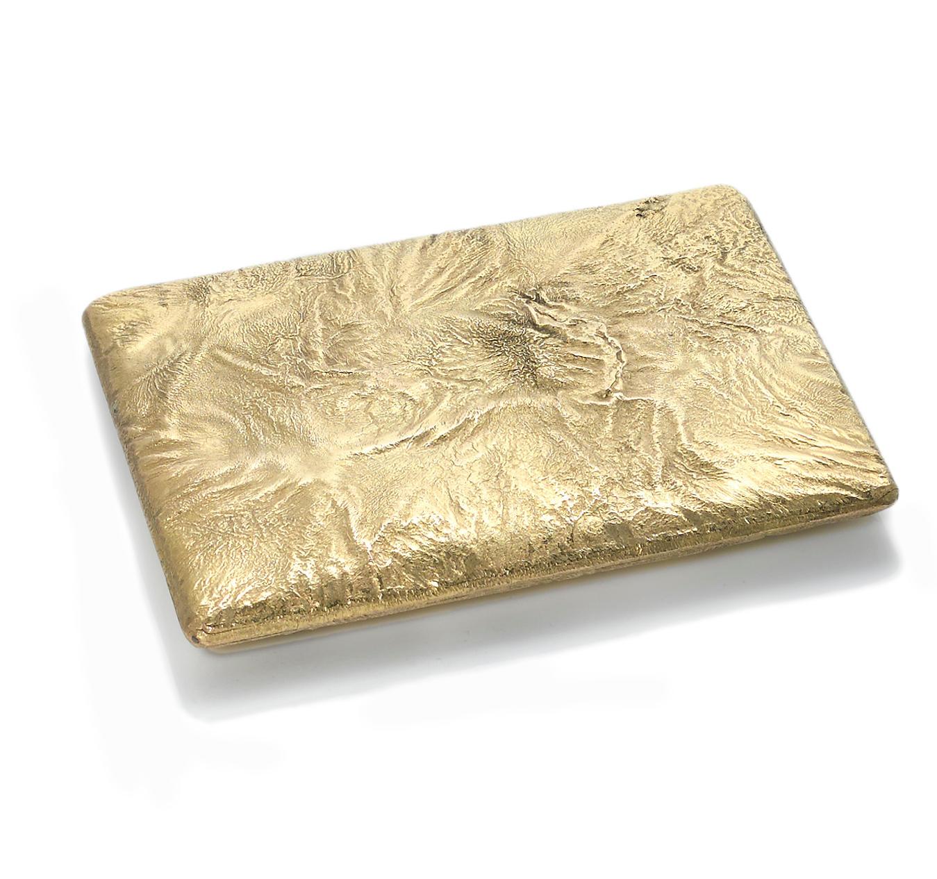 A reticulated nine karat gold
