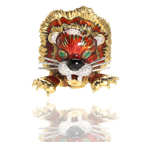 An enamel and diamond lion brooch with emerald eyes, Kutchinsky, London