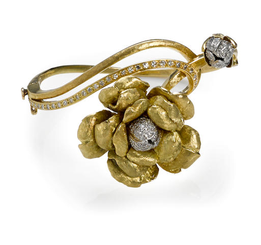 A diamond and eighteen karat gold floral bangle bracelet
