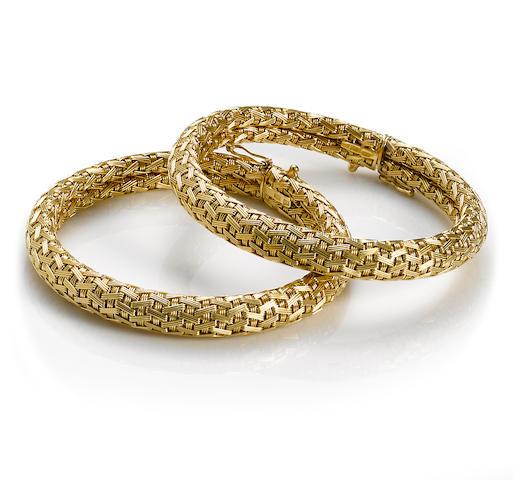 A pair of eighteen karat gold woven motif flexible bangle bracelets