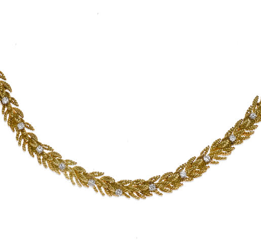 A diamond and eighteen karat gold foliate motif necklace