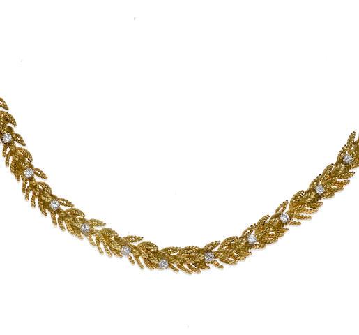 A diamond and eighteen karat gold foliate motif necklace