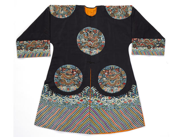 An emperor's embroidered midnight blue silk ground surcoat displaying the twelve imperial symbols, gunfu Late Qing dynasty