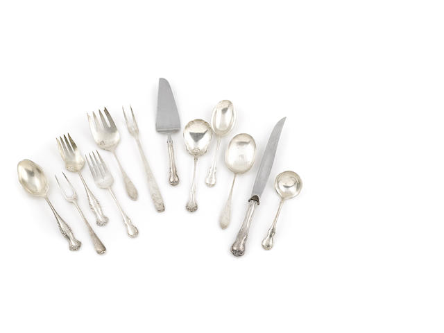 An assorted group of eighteen American sterling silver flatware pieces
