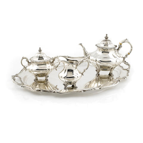 An American  sterling silver  three piece part tea service with matching two-handled tray by Reed & Barton, Taunton, MA 20th century