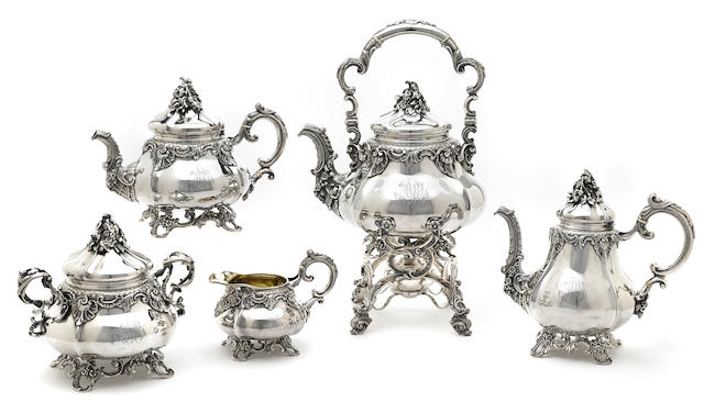 A French first standard silver Rococo style five-piece tea and coffee service, with original canteen by Antoine Cosson; retailed by Cosson-Corby,  Paris, mid-19th century
