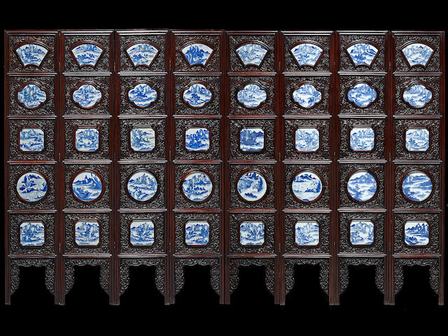 A mixed hardwood eight-panel floor screen inset with blue and white porcelain plaques Late Qing/Republic period