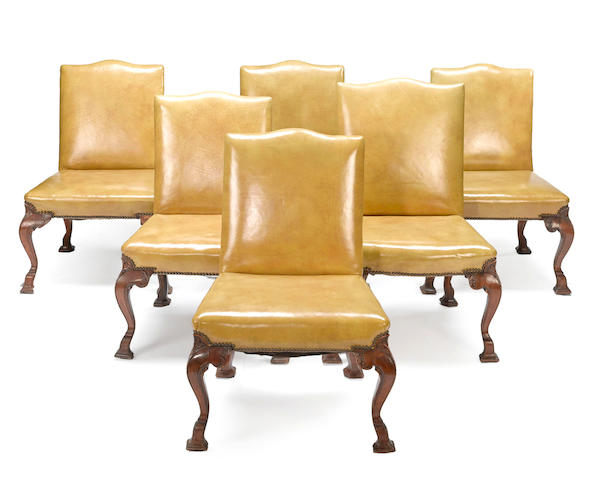 A set of five George II walnut chairs and a later similar example second quarter 18th century