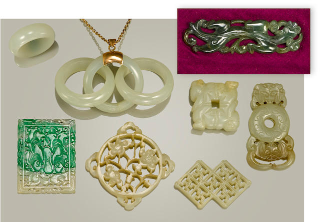 A group of eight small jade and hardstone carvings