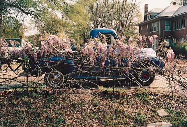 William Eggleston (born 1939); Untitled (Blue Truck with Wisteria), Memphis;