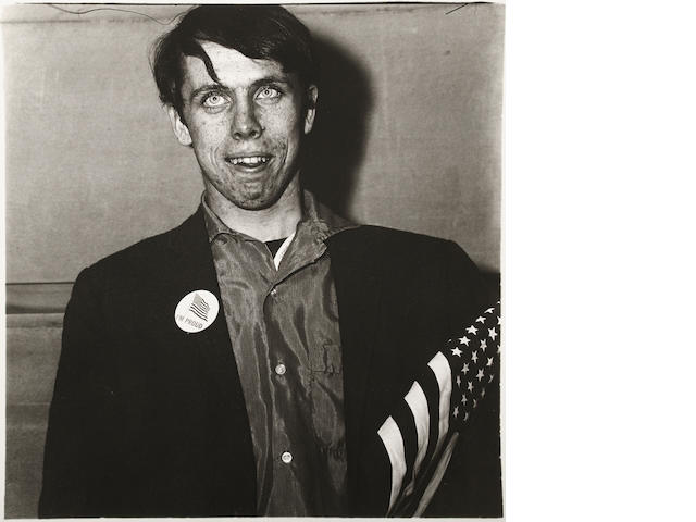 Diane Arbus (1923-1971); Patriotic Young Man with a Flag, N.Y.C.;