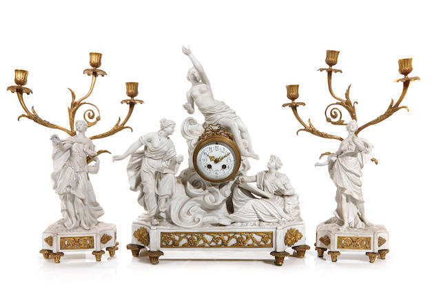 A Sèvres style parian gilt bronze clock garniture