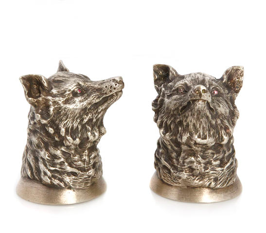 A pair of Russian chased silver fox heads, after 1917, each chased and set with ruby eyes, each stamped Height of each: 2-1/4 inches