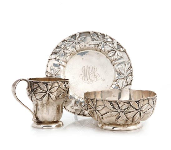 A Gorham sterling silver foliate-decorated three piece place setting - a mug; a bowl and a plate