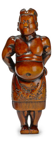 A wood netsuke of a sumo wrestler