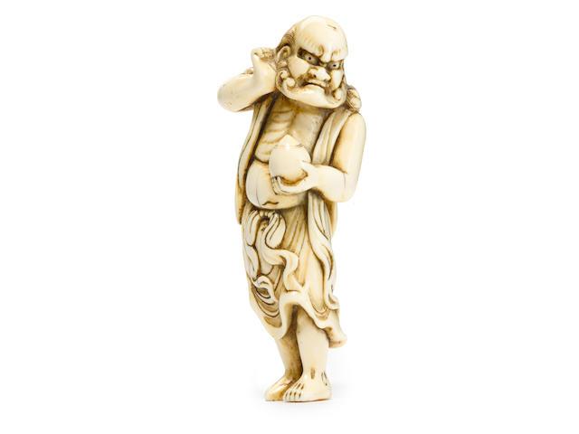 An ivory netsuke of Ryujin holding a tama