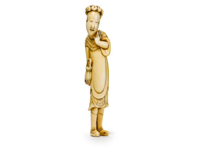 An ivory netsuke of a Chinese court noble