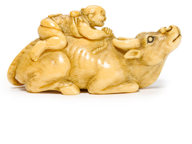 An ivory netsuke of an ox and oxherd by Yoshimoto