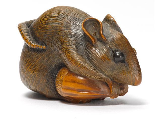 A wood netsuke of a rat with a chestnut By Mitani Goho, Iwami, Edo period (19th century)