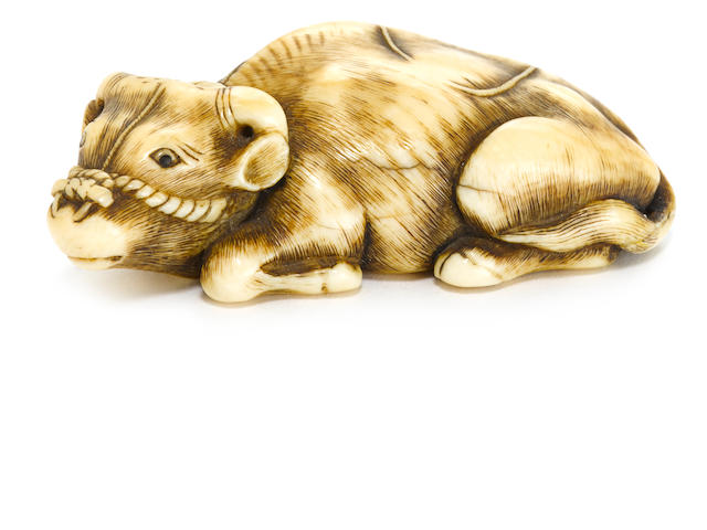 An ivory netsuke of a recumbent ox