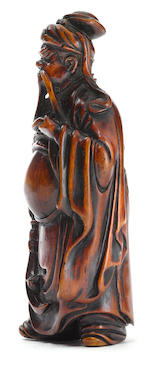 A wood netsuke of Kuan'u, style of Jogyoku