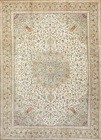 A silk Kashan carpet Central Persia size approximately 9 feet 7 inches x 13 feet 1 inch
