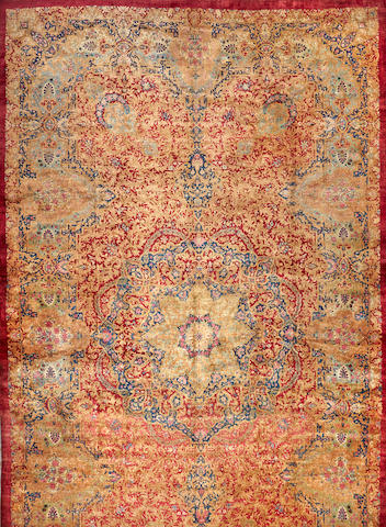 A Kerman carpet  South Central Persia size approximately 14ft. 2in. x 25ft. 1in.
