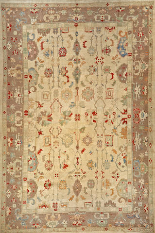 A Turkish carpet Turkey size approximately 12ft. 7in. x 17ft. 5in.