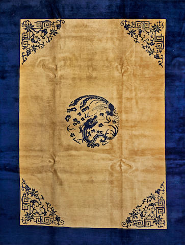 A Chinese carpet  China  size approximately 9ft. 10in. x 11ft. 8in.