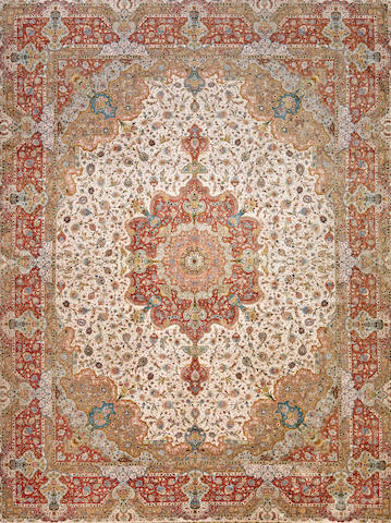 A silk Tabriz carpet Northwest Persia size approximately 9ft. 11in. x 13ft. 4in.