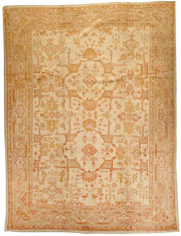 An Oushak carpet West Anatolia size approximately 10ft. x 13ft. 5in.