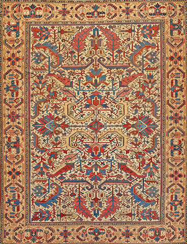 A Heriz carpet Northwest Persia size approximately 9ft. x 11ft.