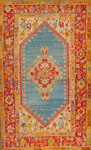 An Oushak carpet  Turkey size approximately 4ft. 2in. x 6ft. 7in.