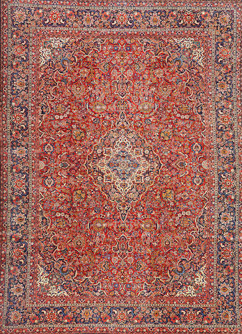 A Kashan carpet  Central Persia size approximately 10ft. 6in. x 14ft. 2in.