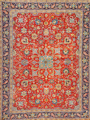 A Tabriz carpet  Northwest Persia size approximately 11ft. 2in. x 14ft. 8in.