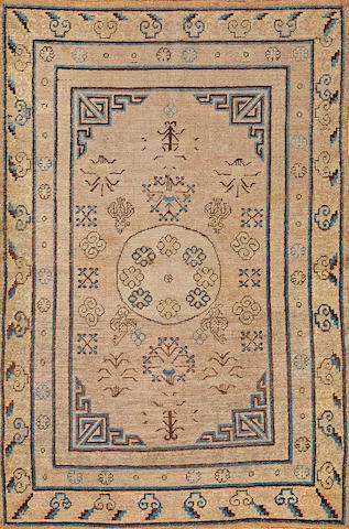 A Khotan rug  Turkestan  size approximately 4ft. 7in. x 6ft. 11in.
