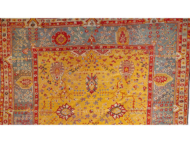 An Oushak carpet West Anatolia size approximately 10ft. 7in. x 19ft. 5in.